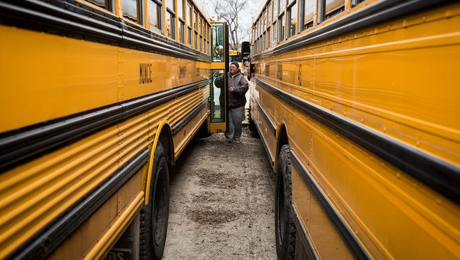 Drivers park their buses at M&M Bus Co. after school Thursday.