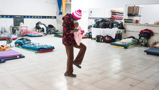 Aline Sainaly Denera, 27, traveled more than 5,000 miles from Brazil through 10 countries to reach the U.S-Mexico border carrying her baby girl, who was 2 months old when they left. She and her husband, Lemon Denera, 32, are from Haiti and moved to Brazil after the 2010 earthquake. But after the economy in Brazil collapsed, they decided to join thousands of Haitians leaving Brazil in hopes of crossing into the U.S. through ports of entry. After arriving in Nogales, Sonora, they slept on vinyl mats on the floor of the Rotary Club, which has been converted into a shelter for Haitian migrants hoping to cross into the U.S.