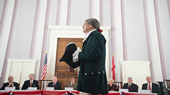 An actor performs as Benjamin Franklin stresses the importance of the Electoral College before the Alabama Electoral College casted their votes Alabama Capitol building on Monday, Dec. 19, 2016, in Montgomery, Ala.