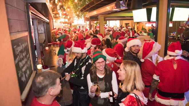 Once again Scottsdale was taken over by the red wave of Santas during the annual Santarchy bar crawl and toy drive on Saturday, Dec. 17, 2016, in Old Town.