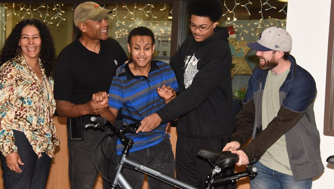 Ventura County Sheriff's Office staff and sworn personnel raised money to buy a tandem bike for an El Rio family. The bike was given to them Thursday.