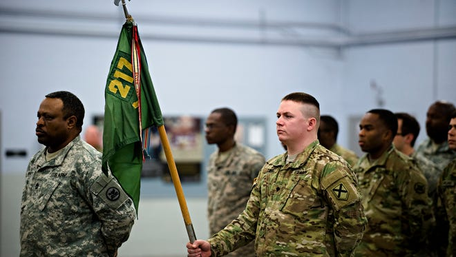 """Members of the 217th Military Police Company stand at attention during the 217th Military Police Company official """"casing of the colors"""" ceremony on Saturday, Jan. 7, 2017, in Montgomery, Ala. 217th Military Police Company of Prattville, Ala., will no longer be an active unit."""