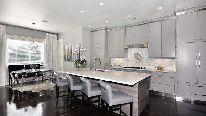 The light and airy kitchen integrates seamlessly with the casual dining space.
