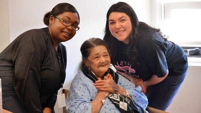 Ana Disla a patient at Clara Maass Medical Center in Belleville gets a little pampering from two Belleville High School cosmetology students on Thursday, Jan. 19, 2017. Students and licensed cosmetologist Kim Paredes, left, worked on Ana's nails and Nortoria Faulk worked on her hair.