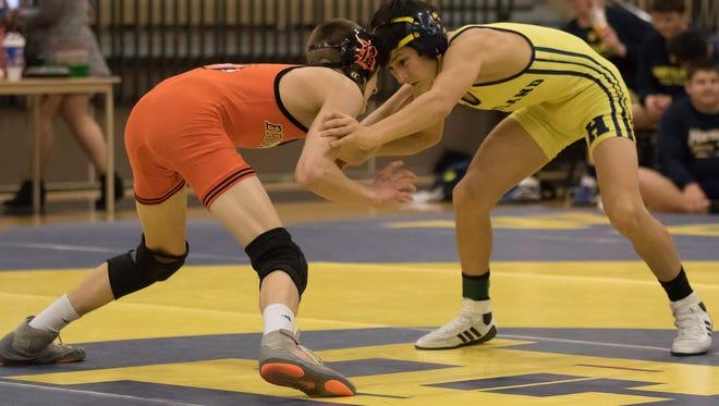 Brighton's Ben Manly (left) beat Hartland's Wyatt Nault in a battle between state-ranked wrestlers last  week.
