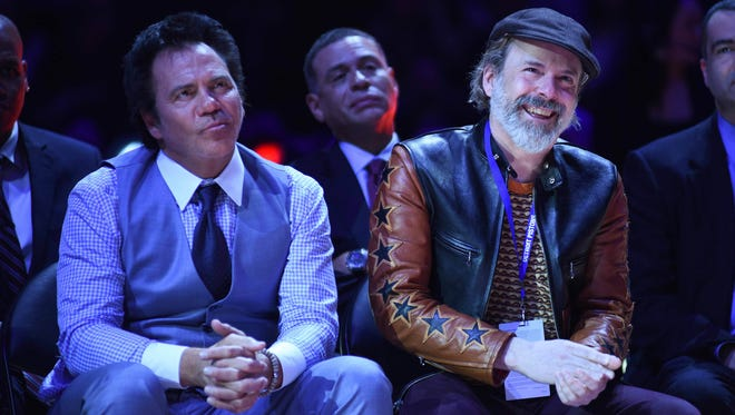 Pistons owner Tom Gores, left, and Ethan Davidson, son of former owner Bill Davidson during the jersey retirement for Richard Hamilton during hafltime of the Pistons' 104-98 loss Sunday at the Palace.