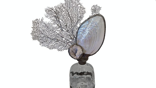 Silver sea fan and geode by Jamie Dietrich, $356, at Aqua Decor & Design.