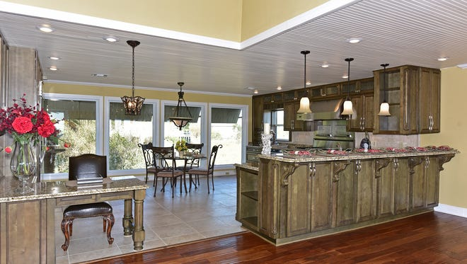 422 Deer Point Drive, the open kitchen with bar seating.