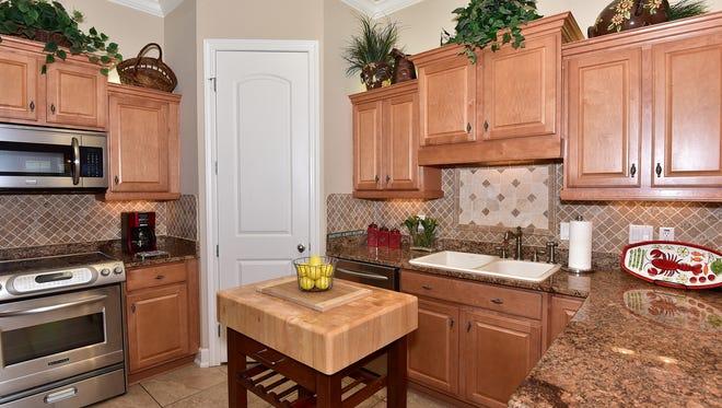 1500 Via Deluna H8, the kitchen includes a prep island.