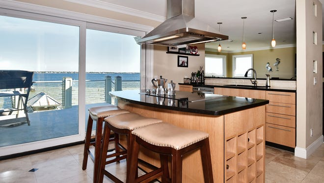 242 Le Starboard Drive, the gourmet kitchen is open and inludes a fabulous view and a center island.