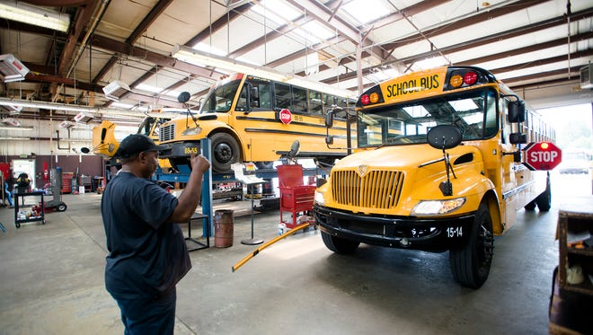 Mechanic Eddie German checks the safety features on a Montgomery School System bus on Thursday, May 11, 2017, in Montgomery, Ala.