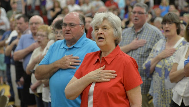 Hundreds say the Pledge of Allegiance at a 2016 Memorial Day ceremony at Upsala High School.