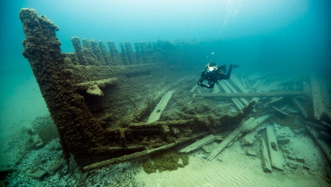 In this May 22, 2013 photo released by the Thunder Bay National Marine Sanctuary, a diver is shown at the Lucinda Van Valkenburg wreckage in the sanctuary boundary waters of Lake Huron near Alpena, Mich.