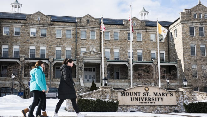 Recent firing of two faculty members and a resignation of the provost at Mount St. Mary?s University has put the college into the spotlight. Students walk across campus at Mount St. Mary's University on Feb. 10, 2016 in Frederick County. Recent firing of two faculty members and a resignation of the provost has brought the small Catholic college into national spotlight.