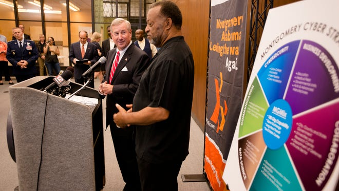 Mayor Todd Strange, left, and County Commissioner Elton Dean speak during a press conference on the Montgomery Internet Exchange on Wednesday, June 7, 2017, in Montgomery, Ala.