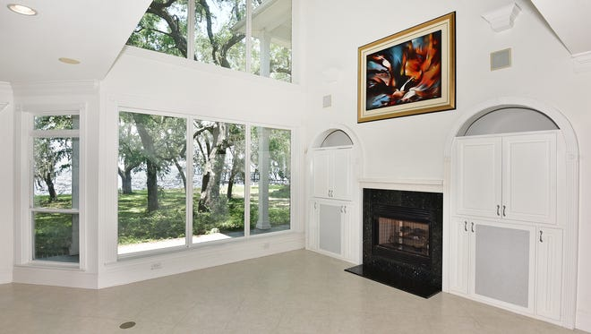 5810 East Bay Boulevard, the spacious living area with a waterfront view.