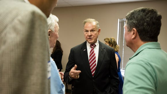 Roy Moore greets people during the River Region Republicans