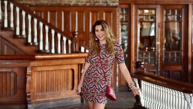 Berry tones are exploding this season! The rich colors and dynamic pattern make this knit dress a winning look for work and beyond. As part of Lee Tracy's travel line it is a pack-and-wear no-iron sensation ($76). Add a Brighton bag in berry for a pop of functional color ($138).