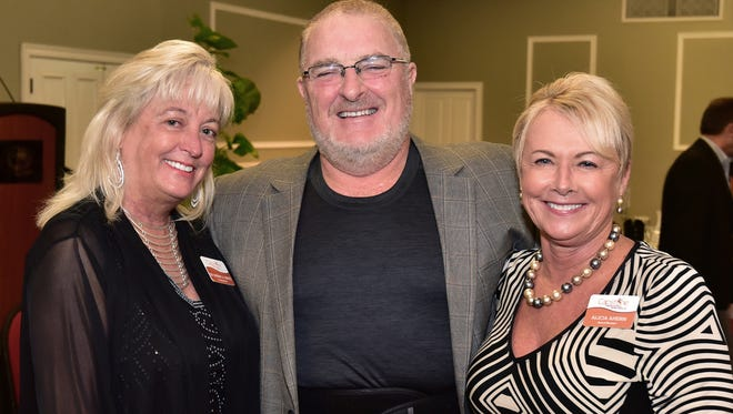Dr. Sherry White, Dan Ahern and Alicia Ahern.