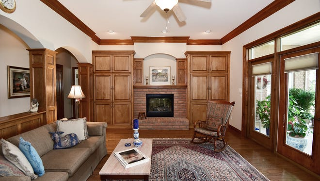 5716 E Bay Boulevard, the living area features a cozy fireplace.