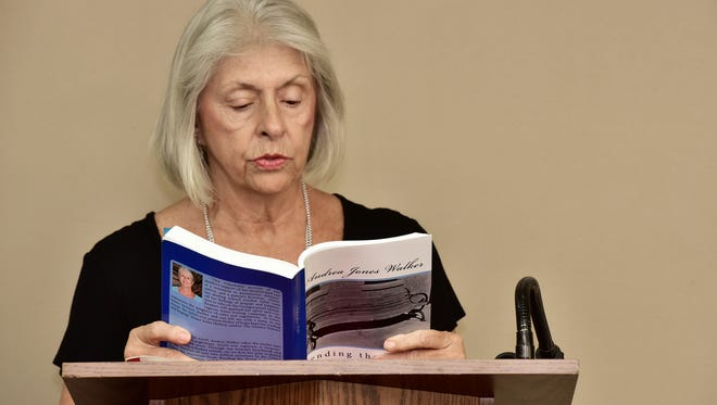 Andrea Walker reads an excerpt from her book to the West Florida Literary Federation.