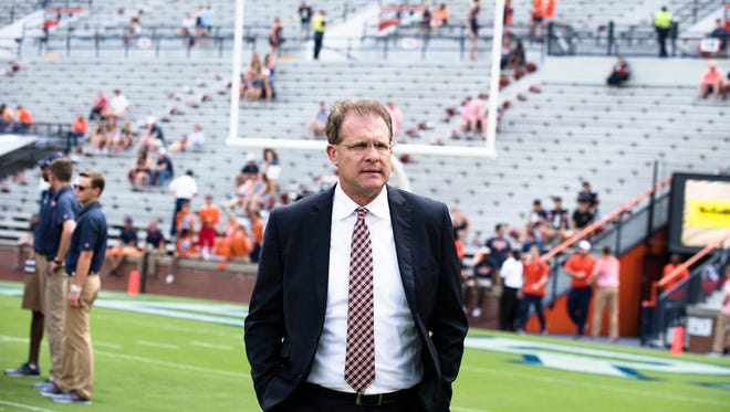 Auburn head coach Gus Malzahn walks the field before the game between Auburn and Mercer on Saturday, Sept. 16, 2017, in Auburn, Ala.