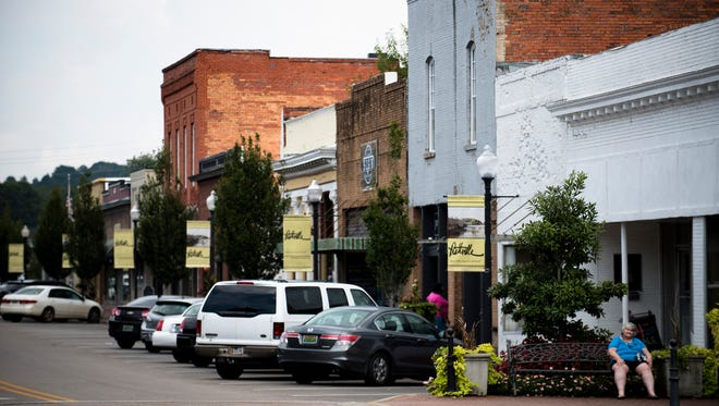 A pedestrian sits in downtown Prattville, Ala., on Monday, Sept. 18, 2017.