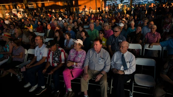 People watch the debate between Roy Moore and Luther