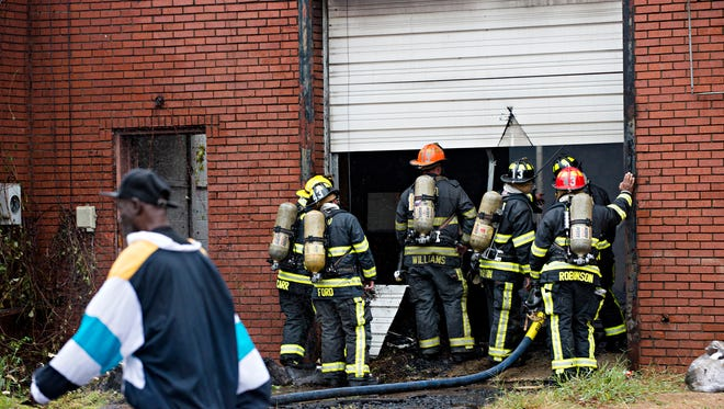 Montgomery Firefighters fight a fire at the corner of Mobile Street and Grady Street on Monday, Oct. 9, 2017 in Montgomery, Ala.