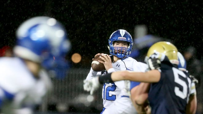 McNary's Erik Barker (12) looks to pass in the first half of the McNary vs. West Albany football game at West Albany High School on Thursday, Oct. 12, 2017.