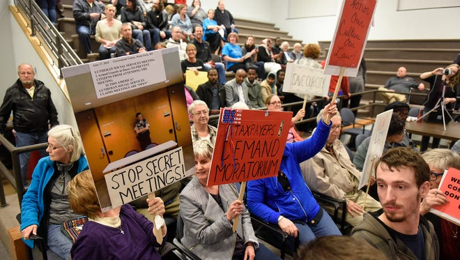 Your Turn author Abdi Mahad, a St. Cloud resident, urges people to speak out against those who support banning refugee resettlement in St. Cloud. This photo is from the Oct. 23 St. Cloud City Council meeting, which addressed the issue.