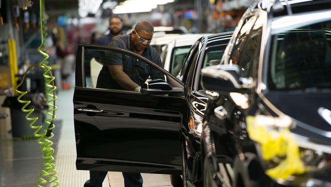 Hyundai employees work on cars on the assembly line at the Hyundai Plant in Montgomery, Ala., on Wednesday, Oct. 25, 2017.