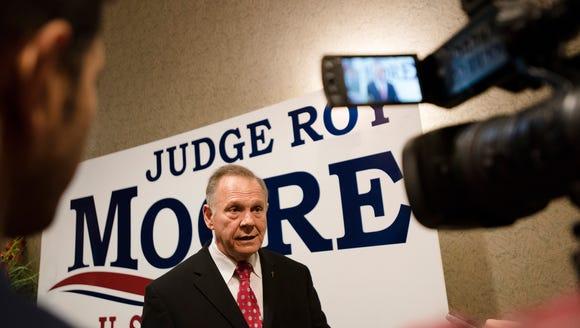 Republican Senate nominee Roy Moore speaks to members