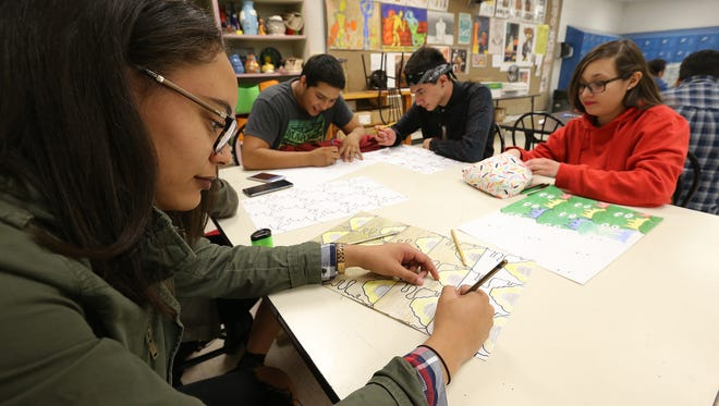 Socorro High School junior Mya Rouse works on an assignment in her art class Tuesday. The Socorro Independent School District has proposed a $448.5 million bond, which would rebuild the crowded school, among other projects.