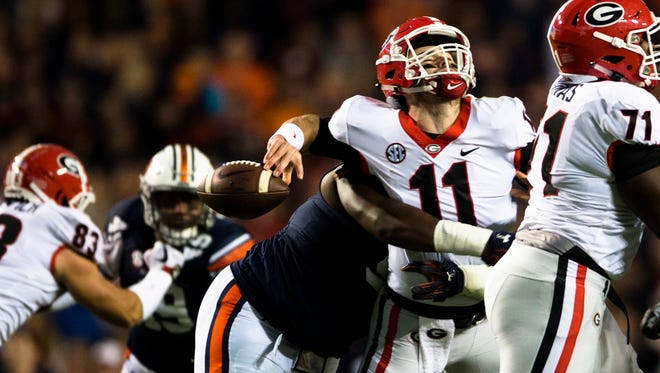 Auburn defensive lineman Dontavius Russell (95) sack Georgia quarterback Jake Fromm (11) forcing a fumble during the NCAA football game between Auburn and Georgia on Saturday, Nov. 11, 2017, in Auburn, Ala.