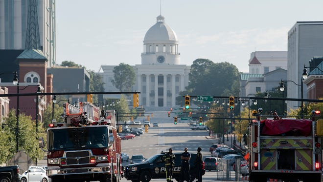Montgomery Firefighters respond to a fire at 39 Dexter Avenue, also known as the Kress Building, in downtown Montgomery, Ala., on Nov. 14, 2017.