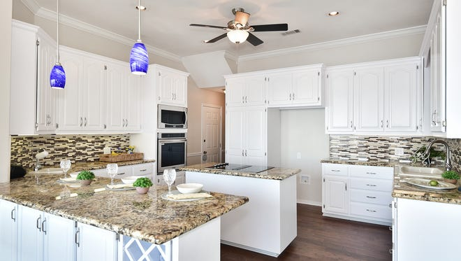3693 Mackey Cove, the open kitchen with an island.