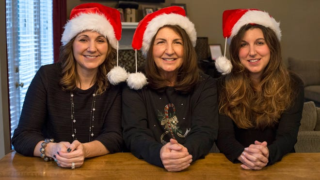 From left: Laura Hardy, 44, at her Clinton Township home with her mother Beverly Vinette, 66, and sister Susie Vinette, 42, get ready for their traditional Black Friday shopping spree.