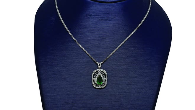 18kt white gold, diamond and emerald pendant, $8,450, at Elebash Jewelry Company.