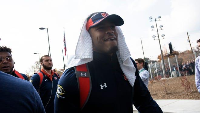 Auburn defensive back Tray Matthews (28) walks in before the SEC Championship Football Game at the Mercedes-Benz Stadium in Atlanta, GA., in Saturday, Dec. 2, 2017.