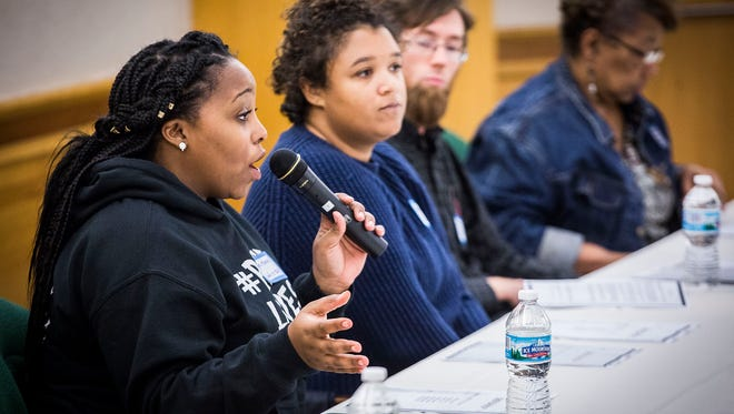 Kyra Harvey of Indy10 Black Lives Matter serves as a panelist during a RACE meeting at Minnetrista Tuesday night.