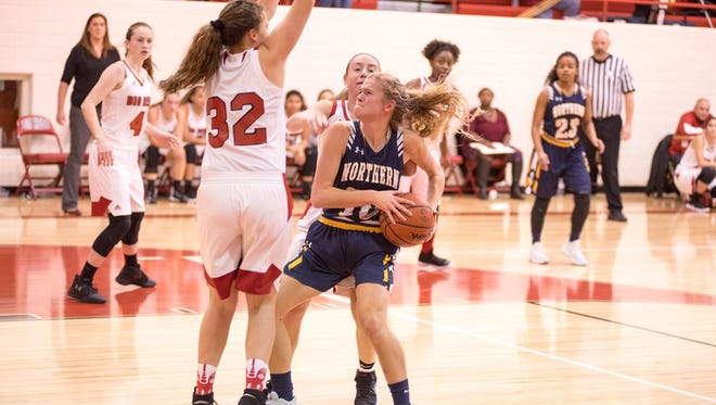 Players from Port Huron High School try to block Northern's Sami Klink (10) as she looks to shoot the basketball during their game Dec. 8.