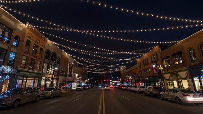 Lights hanging over Huron Avenue in downtown Port Huron give the town a warm glow Dec. 20.
