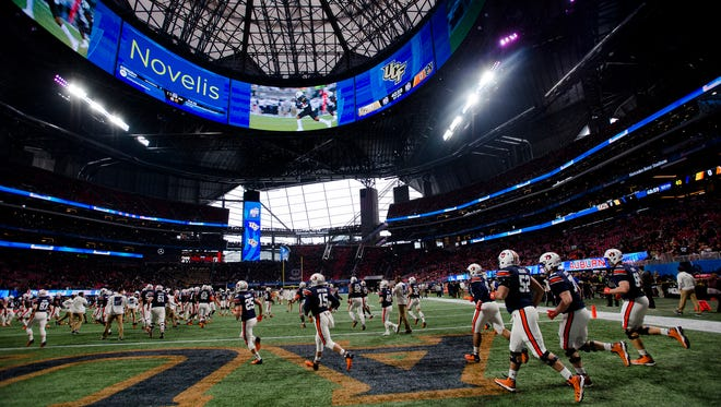 Auburn takes the field before the Peach Bowl against UCF on Monday, Jan. 1, 2018, at Mercedes-Benz Stadium in Atlanta, Ga.