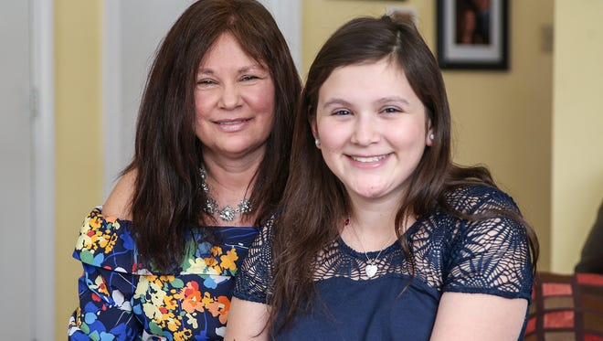 """From left, Tasha Simons and daughter Bella Simons pose for a picture at their Carmel, Ind. home, Wednesday, Jan. 3, 2017. """"We both need each other,"""" Tasha said. """"She's my heart and I'm really afraid of losing her."""""""