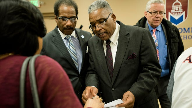 Robert Porterfield, Montgomery Public School Board president, prepares for a press conference after a Board Meeting on Friday, Jan. 5, 2018, in Montgomery, Ala.