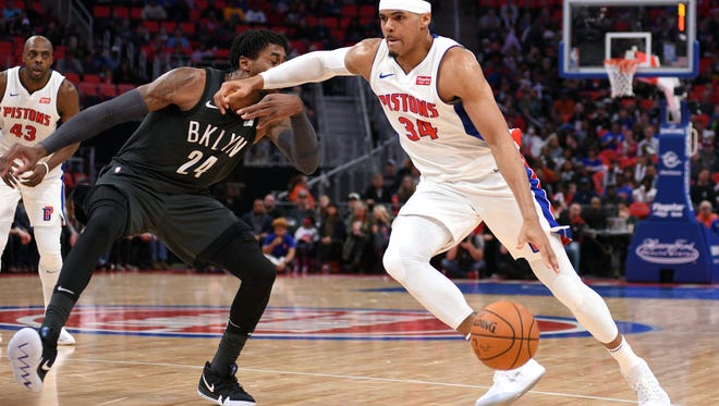 Pistons forward Tobias Harris (34) drives to the basket and fouls Nets forward Rondae Hollis-Jefferson (24) during the second quarter on Sunday, Jan. 21, 2018, at Little Caesars Arena.