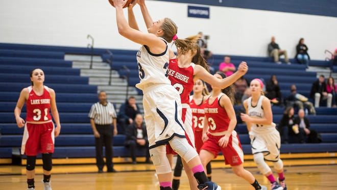 Marysville High School's Hannah Delor (23) jumps to shoot the ball but is blocked by Lake Shore's Emma Michael during the Pink Out basketball game at Marysville High School Jan. 25.