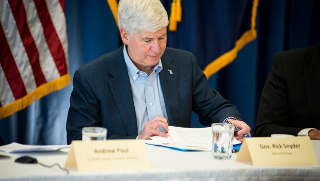 Gov. Rick Snyder signs an executive order creating the Michigan Consortium of Advanced Networks during a roundtable discussion at the Blue Water Convention Center in Port Huron Jan. 29. The commission will have until Aug. 1 to come up with a plan to address broadband issues statewide.