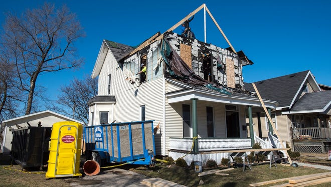 Work is eing done on the house at 1515 Seventh St. in Port Huron. The house, which was damaged by a fire that was ruled suspicious in nature, was given to the city and will be fixed up and sold.
